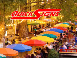 Quicksigns Logo over SA riverwalk image
